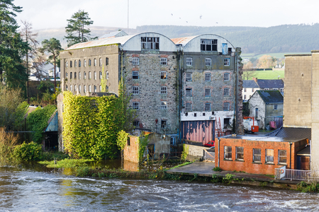 inundated: Photo of Suir river flooding the buildings