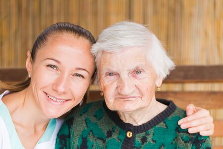 home care: Photo of elderly woman with her caregiver