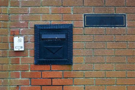 interphone: Photo of black iron letterbox and interphone Stock Photo