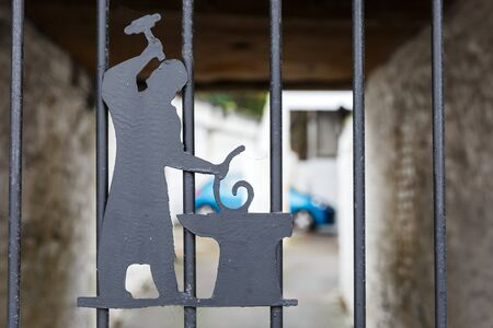 iron fence: Photo of symbolic blacksmith on iron fence