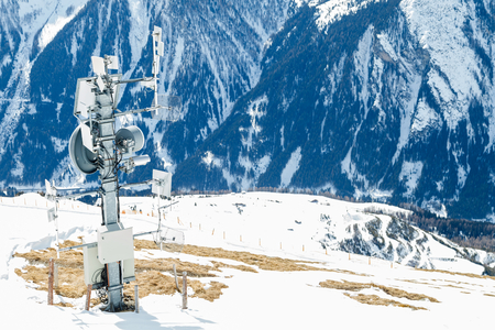 covered in snow: Photo of signal transmitter in the snowy mountains