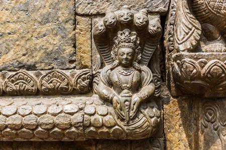 deity: Close up photo of hindu deity stone relief Stock Photo