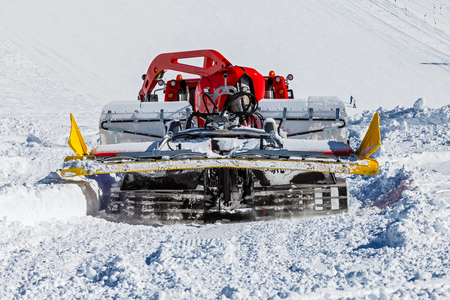 snow grooming machine: Photo of red ratrak in action on the ski slope Stock Photo