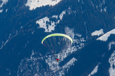paraglider: Photo of paraglider in the snowy mountains