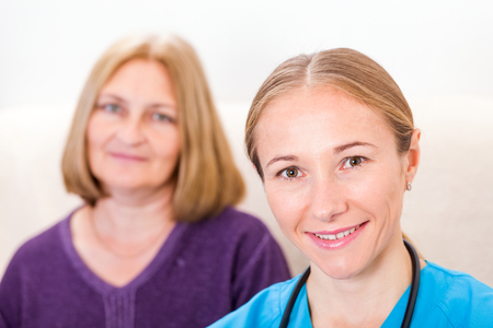 aide: Photo of middle aged woman with the young doctor