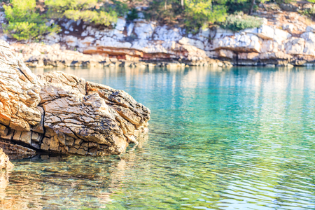clear water: Landscape photo of rocky adriatic shore and crystal clear water Stock Photo