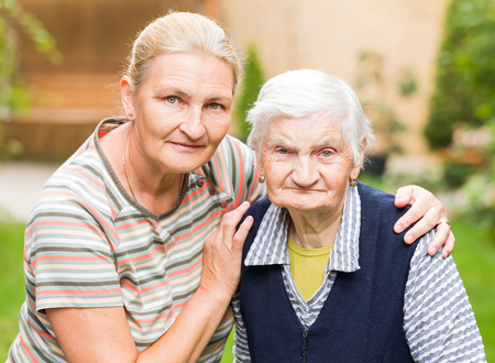 Photo of elderly woman with her daughter Stock Photo