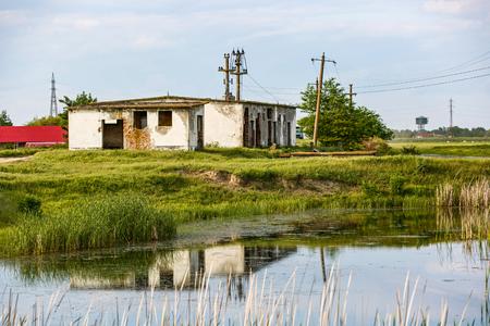 periphery: Photo of abandoned building near to lake