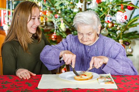 ageing: Photo of elderly women with the young carer