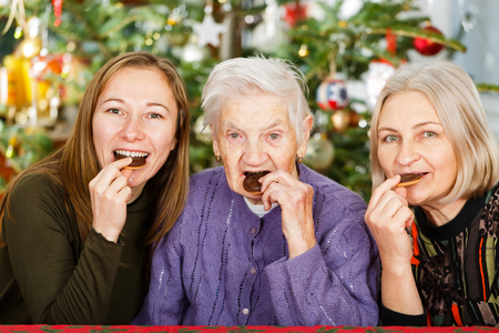 carers: Photo of elderly woman and her carers having fun