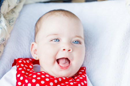 Portrait photo of blue eyed adorable baby girl