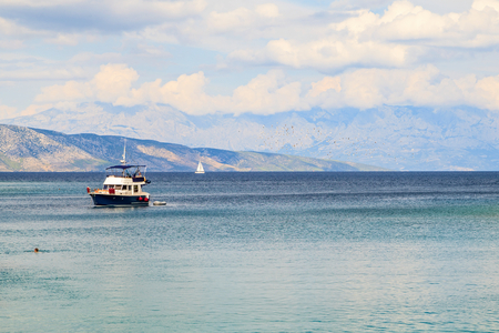 croatian: Beautiful view of Adriatic sea and Dalmatian mountains on the background