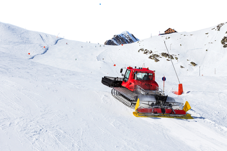 Photo of red ratrak in action on the ski slope Stock Photo