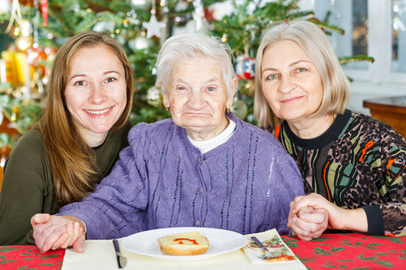 aide: Photo of elderly woman and her carers