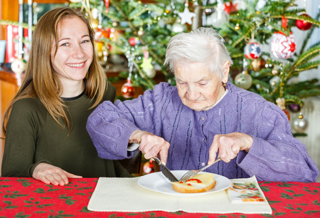 Photo of elderly women with the young carer photo
