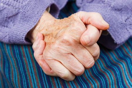 incapacitated: Close up photo of clasped elderly woman hands