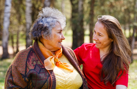 Portrait photo of happy elderly woman with her daughter Stock Photo