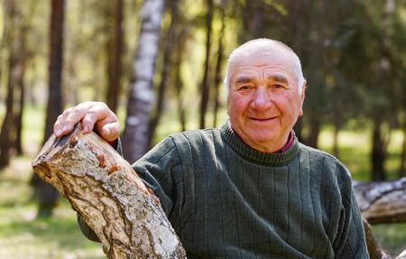 Portrait photo of happy elderly man in the nature Stock Photo
