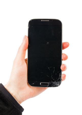 Close up of broken smartphone on isolated white background Stock Photo