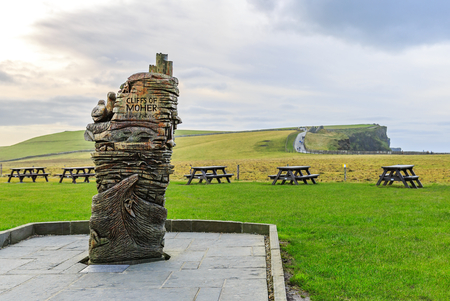 Photo of a wood statue in the entrance of Cliffs of Moher