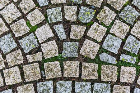 Close up photo of cobblestone way texture