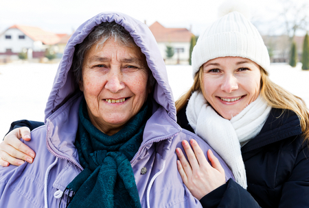 Photo of happy elderly woman and young caregiver Stock Photo