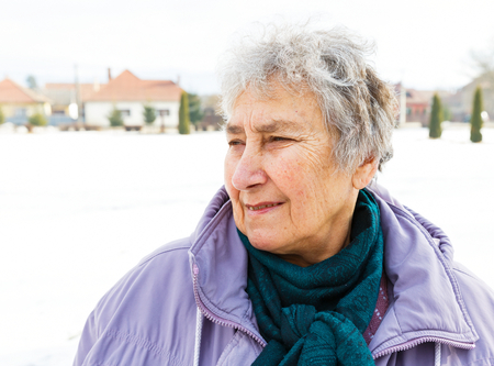 Portrait photo of a cute smiling elderly woman photo