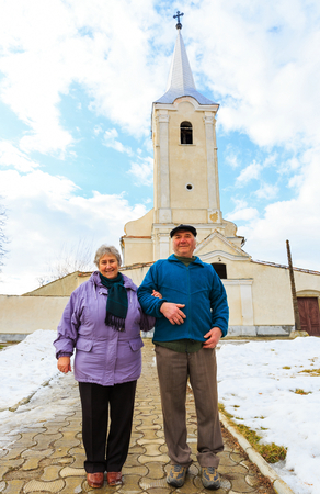Photo of elderly couple going to the church photo