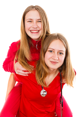 Young female doctor and her sister having fun Standard-Bild