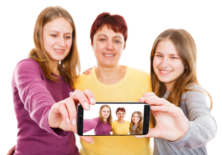 Self portrait photo of happy mother with daughters
