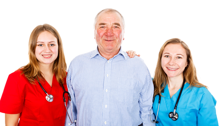 Photo of senior man and young female doctors