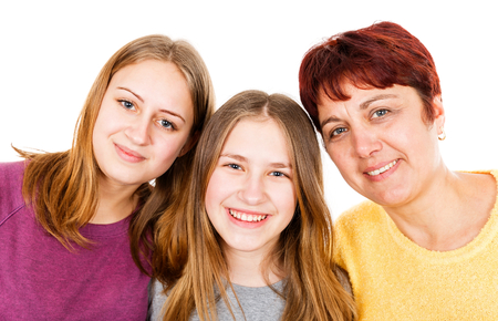 Portrait photo of happy mother with daughters