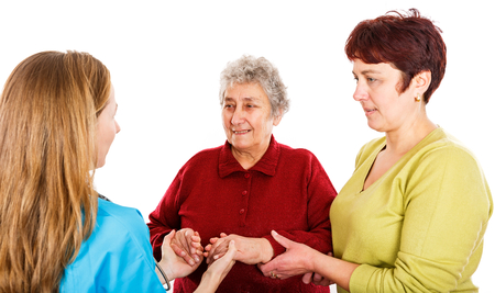 Elderly woman with carer visit the young female doctor Standard-Bild