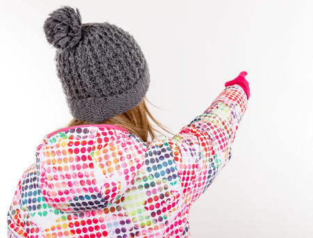 Photo of young girl pointing with her finger
