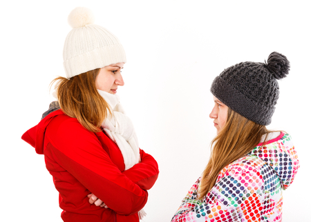 Portrait photo of beautiful young sisters arguing Stock Photo