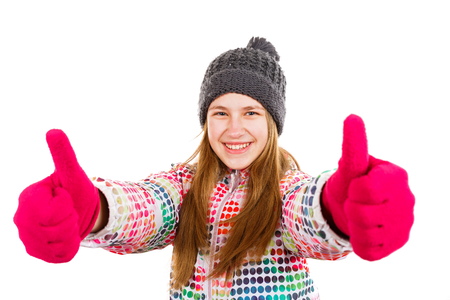 all ok: Photo of smiling young girl showing thumbs up