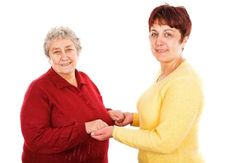 Foto van jonge verzorger bedrijf oudere vrouw handen Stockfoto