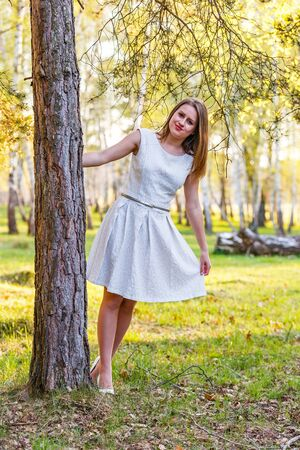 Photo of beautiful young lady in the forest