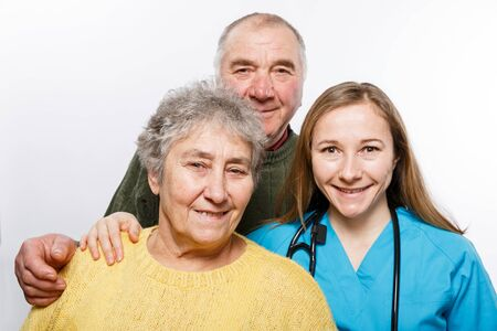 Nurse and elderly couple taking a selfie to send it to the relatives to show that everything is going well.