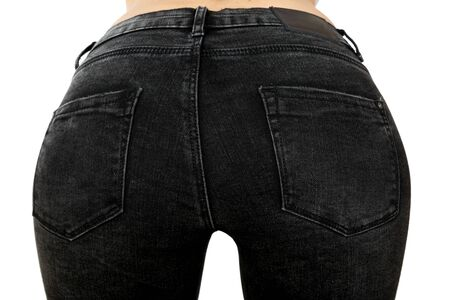 Back of tanned slim model woman in black jeans on white background Standard-Bild
