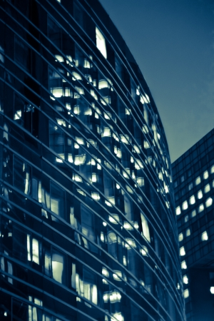 modern  illuminated office building, at night, blue tone photo