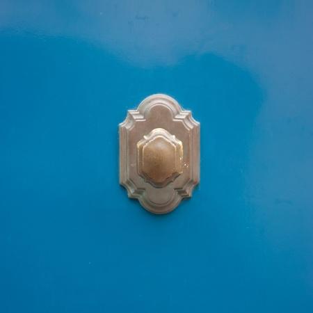 cocooning: Ancient Door Handle on blue wood Stock Photo