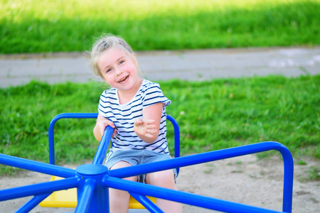 Adorable little girl on carousel