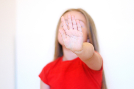 denial: Small girl shows denial with her hand Stock Photo