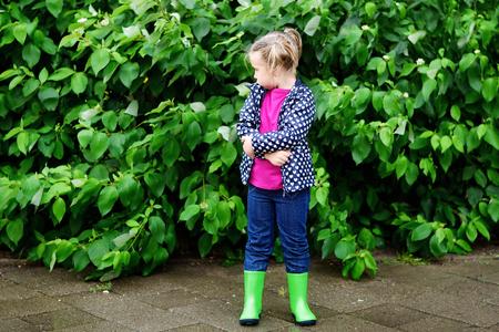 Adorable sad toddler girl at rainy day Stok Fotoğraf