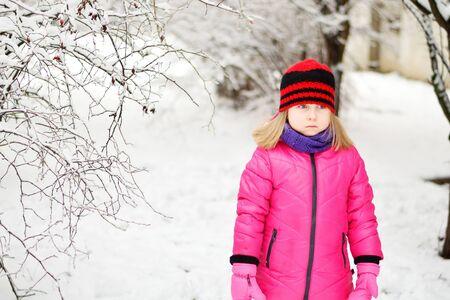 Sad little girl in beautiful winter park Stok Fotoğraf