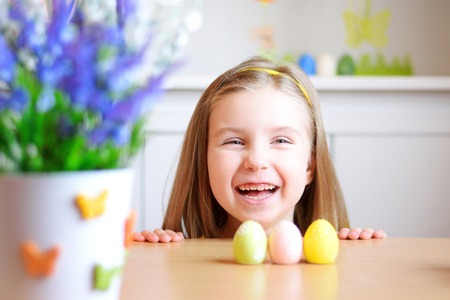 Happy smiling girl celebrate Easter at home Stok Fotoğraf