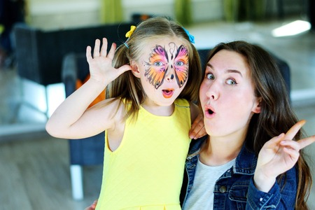 Pretty girl with face painting of a butterfly Stok Fotoğraf
