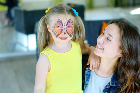 bodyart: Pretty girl with face painting of a butterfly Stock Photo