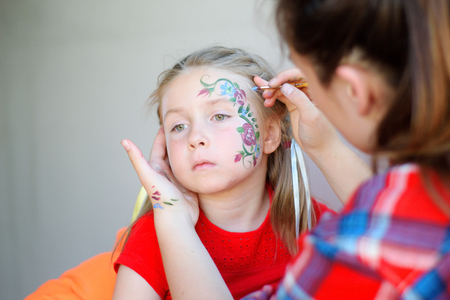 Adorable girl with painted face by animator Stok Fotoğraf